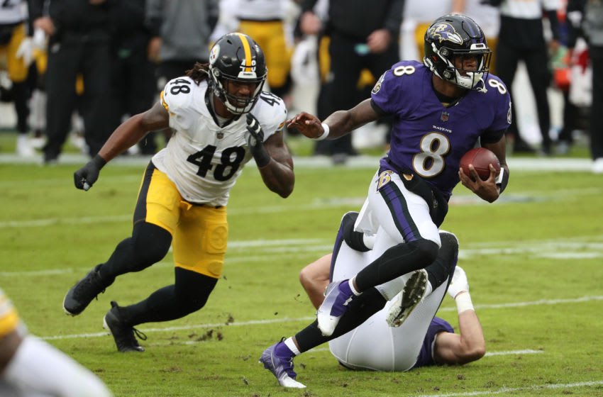 BALTIMORE, MARYLAND - NOVEMBER 01: Quarterback Lamar Jackson #8 of the Baltimore Ravens rushes with the ball against the Pittsburgh Steelers at M&T Bank Stadium on November 01, 2020 in Baltimore, Maryland. (Photo by Patrick Smith/Getty Images)