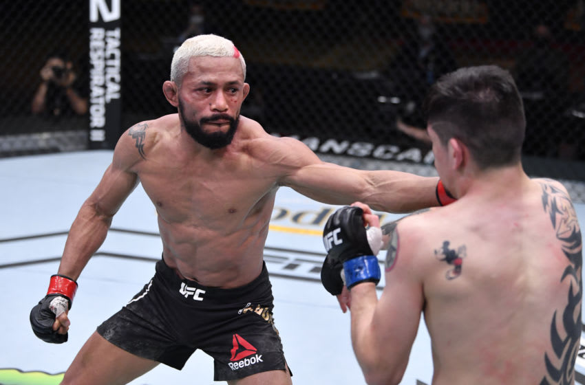 LAS VEGAS, NEVADA - DECEMBER 12: (L-R) Deiveson Figueiredo of Brazil punches Brandon Moreno of Mexico in their flyweight championship bout during the UFC 256 event at UFC APEX on December 12, 2020 in Las Vegas, Nevada. (Photo by Jeff Bottari/Zuffa LLC)