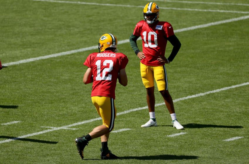 GREEN BAY, WISCONSIN - AUGUST 20: Aaron Rodgers #12 of the Green Bay Packers participates in a drill as Jordan Love #10 looks on during Green Bay Packers Training Camp at Lambeau Field on August 20, 2020 in Green Bay, Wisconsin. (Photo by Dylan Buell/Getty Images)