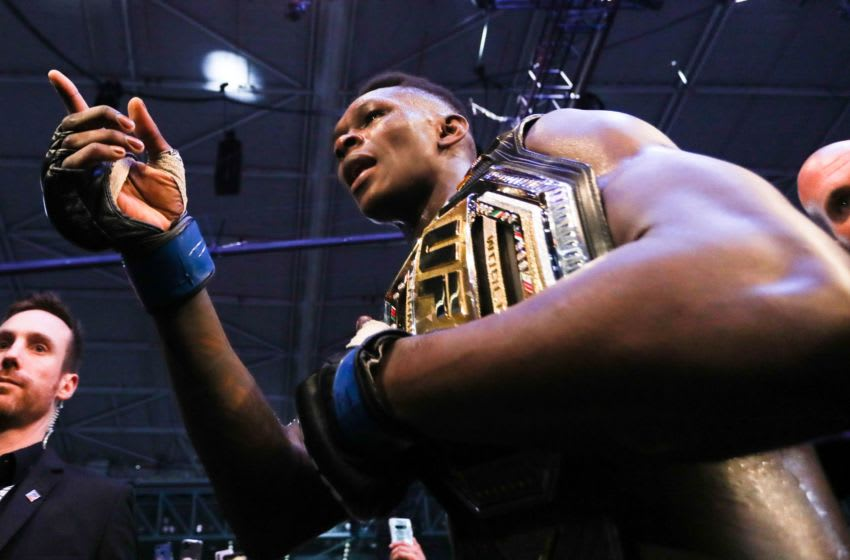 Middleweight title winner Israel Adesanya of New Zealand celebrates after defeating Robert Whittaker of Australia during the middleweight title bout of the UFC 243 fight night in Melbourne on October 6, 2019. (Photo by ASANKA BRENDON RATNAYAKE / AFP) / -- IMAGE RESTRICTED TO EDITORIAL USE - STRICTLY NO COMMERCIAL USE -- (Photo by ASANKA BRENDON RATNAYAKE/AFP via Getty Images)