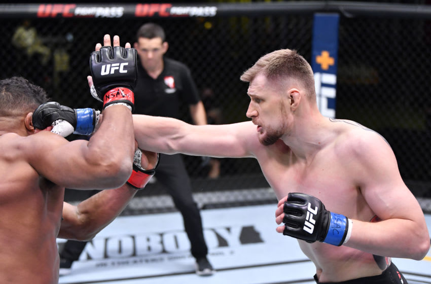 LAS VEGAS, NEVADA - FEBRUARY 06: (R-L) Alexander Volkov of Russia punches Alistair Overeem of the Netherlands in their heavyweight fight during the UFC Fight Night event at UFC APEX on February 06, 2021 in Las Vegas, Nevada. (Photo by Chris Unger/Zuffa LLC)