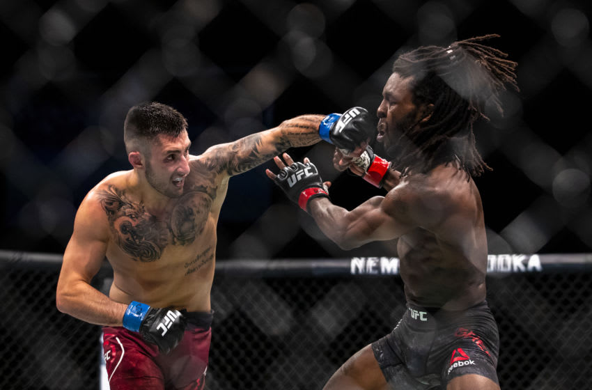 ROCHESTER, NY - MAY 18: Charles Jourdain (left) throws a punch against Desmond Green (right) at Blue Cross Arena on May 18, 2019 in Rochester, New York. Green defeats Jourdain via unanimous decision. (Photo by Brett Carlsen/Getty Images)