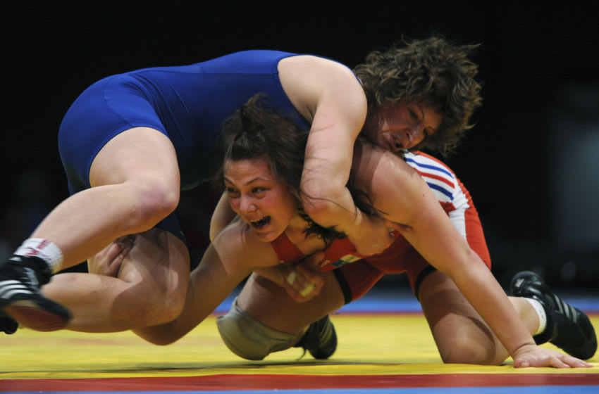 Cinthya Vanessa Vescan (R, in red) from France fights with Stanka Zlateva Hristova from Bulgaria in the final for the third place of the European Wrestling Championship 72 kg freestyle woman event in Dortmund, western Germany, on April 1, 2011. Hristova won the fight. AFP PHOTO / PATRIK STOLLARZ (Photo credit should read PATRIK STOLLARZ/AFP via Getty Images)